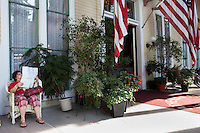 Relaxing on porches on the Athenaeum Hotel at Chautauqua. Chautauqua, NY. June 27, 2014. Photo by Brendan Bannon