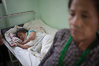 A young victim of earthquake under treatment in a hospital of Kathmandu, Nepal.  A 7.3 magnitude earthquake killed at least 37 people and spread panic in Nepal on Tuesday, bringing down buildings already weakened by a devastating tremor less than three weeks ago and unleashing landslides in Himalayan valleys near Mount Everest. Kathmandu, Nepal. May 12, 2015