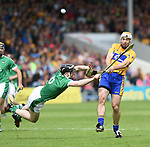 Conor McGrath of Clare in action against Declan Hannon of Limerick during their Munster Championship semi-final at Thurles.  Photograph by John Kelly.
