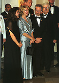 Kate Capshaw (in blue) and her husband, Steven Spielberg, await their introduction to United States President Bill Clinton and first lady Hillary Rodham Clinton at the 1999 Medal of Arts and Humanities Dinner at the White House in Washington, D.C. on September 29, 1999..Credit: Ron Sachs / CNP