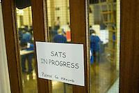 State Primary School.  SATS sign on the exam door.