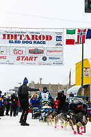 Jason Campeau and team leave the ceremonial start line with an Iditarider and handler at 4th Avenue and D street in downtown Anchorage, Alaska on Saturday March 7th during the 2020 Iditarod race. Photo copyright by Cathy Hart Photography.com