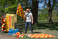 Merchandise is sold from a stall in the Park to supporters arriving for The Watford FC Promotion Parade at Cassiobury Park, Watford, England on 4 May 2015. Photo by Andy Rowland.