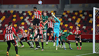 Brentford goalkeeper, David Raya, punches the ball clear to foil a Sheffield Wednesday attack during Brentford vs Sheffield Wednesday, Sky Bet EFL Championship Football at the Brentford Community Stadium on 24th February 2021