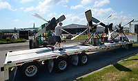 John Dunlap, a truck driver with One Feather Trucking in Foley, Ala., helps Thursday, June 3, 2021, to guide Jose Reyes of White Aviation, as he uses a forklift to unload a set of four propellers for a Lockheed C-130 Hercules at the Arkansas Air and Military Museum in Fayetteville. The propellers are being fitted to the plane to aid in its conservation. The company will be in town for about a week and will replace a few parts before positioning the plane onto its newly completed concrete pad adjacent to the museum. Visit nwaonline.com/210604Daily/ for today's photo gallery.<br /> (NWA Democrat-Gazette/Andy Shupe)