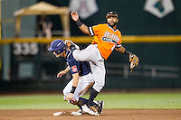 Oklahoma State Cowboys second baseman J.R. Davis (2) turns a double play as Arizona Wildcats baserunner Jared Oliva (42) slides into second during Game 6 of the NCAA College World Series on June 20, 2016 at TD Ameritrade Park in Omaha, Nebraska. Oklahoma State defeated Arizona 1-0. (Andrew Woolley/Four Seam Images)