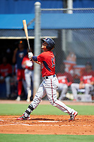 GCL Twins center fielder Jean Carlos Arias (13) follows through on a swing during the first game of a doubleheader against the GCL Rays on July 18, 2017 at Charlotte Sports Park in Port Charlotte, Florida.  GCL Twins defeated the GCL Rays 11-5 in a continuation of a game that was suspended on July 17th at CenturyLink Sports Complex in Fort Myers, Florida due to inclement weather.  (Mike Janes/Four Seam Images)