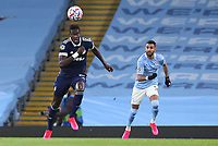 3rd November 2020; City of Manchester Stadium, Manchester, England. UEFA Champions League group stages, Manchester City versus Olympiacos;  Pape Abou Cisse (OL) breaks from Ferran Torres Manchester City