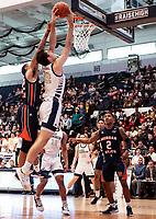 WASHINGTON, DC - NOVEMBER 16: David Syfax Jr. #32 of Morgan State defends  shot by Javier Langarica #32 of George Washington during a game between Morgan State University and George Washington University at The Smith Center on November 16, 2019 in Washington, DC.