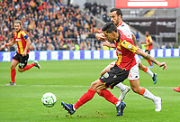 20191102 – Lens , France : Florian Sotoca (7) of Lens pictured in a duel with Matthieu Saunier (20) of Lorient during a French Ligue 2 soccer game between Racing Club de Lens and FC Lorient , a football game on the 13th matchday in the French second league, on saturday 2 nd of November 2019 at the Stade Bollaert Delelis in Lens , France . PHOTO SPORTPIX.BE | DAVID CATRY