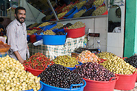 Tripoli, Libya - Olive Vendor, with lemons, peppers, pickled carrots