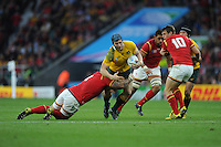 David Pocock of Australia is tackled by Paul James of Wales during Match 35 of the Rugby World Cup 2015 between Australia and Wales - 10/10/2015 - Twickenham Stadium, London<br /> Mandatory Credit: Rob Munro/Stewart Communications