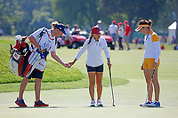 5th September 2021; Toledo, Ohio, USA;  Danielle Kang of Team USA talks with Georgia Hall of Team Europe on the 18th green during  the morning Four-Ball competition during the Solheim Cup on September 5th
