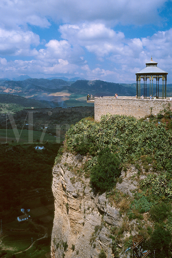 Scenic overlook with view of farm land in the valley below the city. During the Spanish Civil War political prisoners were thrown from these cliffs. Ronda Andalucia Spain.