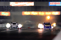 May 18, 2012; Topeka, KS, USA: NHRA funny car driver Ron Capps (right) races alongside Mike Neff during qualifying for the Summer Nationals at Heartland Park Topeka. Mandatory Credit: Mark J. Rebilas-