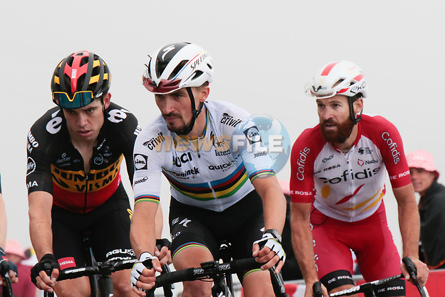 Belgian Champion Wout Van Aert (Bel) Jumbo-Visma, World Champion Julian Alaphilippe (Fra) Deceuninck-Quick Step and Simon Geschke (GER) Cofidis round the final hairpin on Col du Portet during Stage 17 of the 2021 Tour de France, running 178.4km from Muret to Saint-Lary-Soulan Col du Portet, France. 14th July 2021.  <br /> Picture: Colin Flockton   Cyclefile<br /> <br /> All photos usage must carry mandatory copyright credit (© Cyclefile   Colin Flockton)