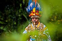 """A shaman from the Kamentsá tribe, wearing a colorful feather headgear, plays flute during the Carnival of Forgiveness, a traditional indigenous celebration in Sibundoy, Colombia, 12 February 2013. Clestrinye (""""Carnaval del Perdón"""") is a ritual ceremony kept for centuries in the Valley of Sibundoy in Putumayo (the Amazonian department of Colombia), a home to two closely allied indigenous groups, the Inga and Kamentsá. Although the festival has indigenous origins, the Catholic religion elements have been introduced and merged with the shamanistic tradition. Celebrating annually the collaboration, peace and unity between tribes, they believe that anyone who offended anyone may ask for forgiveness this day and all of them should grant pardons."""