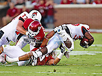Oklahoma Sooners linebacker Travis Lewis (28) and Ball State Cardinals running back Jahwan Edwards (38) in action during the game between the Ball State Cardinals  and the Oklahoma Sooners at the Oklahoma Memorial Stadium in Norman, Oklahoma. OU defeats Ball State 62 to 6.