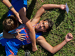 North East's Marcus Beckert collapses in exhaustion with teammates after the quad cross country meet at North East High School in North East, Maryland on September 11, 2012 featuring boys and girls from North East, Elkton, Aberdeen and Edgewood High School's.