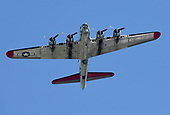 A B17 flies over in honor of Connie Kalitta
