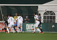 Ethan White (15) of D.C. United watches a deflection by Mike Magee (18) of the Los Angeles Galaxy hit the net for a goal during an MLS match at RFK Stadium, on April 9 2011, in Washington D.C.The game ended in a 1-1 tie.