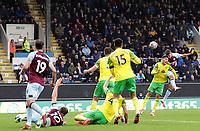2nd October 2021;  Turf Moor, Burnley, Lancashire, England; Premier League football, Burnley versus Norwich City: Matthew Lowton of Burnley heads narrowly over the Norwich crossbar