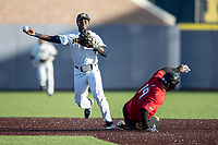 Michigan Wolverines second baseman Ako Thomas (4) turns a double play against the Rutgers Scarlet Knights on April 26, 2019 in the NCAA baseball game at Ray Fisher Stadium in Ann Arbor, Michigan. Michigan defeated Rutgers 8-3. (Andrew Woolley/Four Seam Images)