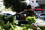 A Palestinian vendor sells Lettuce at a cart during the Muslim holy month of Ramadan, in Gaza City on April 22, 2021 amid the coronavirus disease (COVID-19) outbreak. Palestinians welcomed the Muslim fasting month of Ramadan under the shadow of economic difficulties caused by the Israeli blockade and the coronavirus pandemic. Nineteen people have died of the coronavirus disease in Palestine in the last 24 hours and 1652 new cases were recorded, according to the daily report on the disease. Health Minister Mai Alkaila said 11 of the dead and 1179 of the new cases were in the Gaza Strip. Photo by mohammed salem