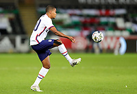SWANSEA, WALES - NOVEMBER 12: Reggie Cannon #20 of the United States traps a ball during a game between Wales and USMNT at Liberty Stadium on November 12, 2020 in Swansea, Wales.