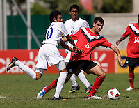 Jose Escalante (20) of Honduras fights for the ball with Ismail Benomar (4) of Canada during the group stage of the CONCACAF Men's Under 17 Championship at Catherine Hall Stadium in Montego Bay, Jamaica. Canada tied Honduras, 0-0.