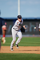 Staten Island Yankees first baseman Eric Wagaman (22) flips to the pitcher covering first base during a game against the Lowell Spinners on August 22, 2018 at Richmond County Bank Ballpark in Staten Island, New York.  Staten Island defeated Lowell 10-4.  (Mike Janes/Four Seam Images)