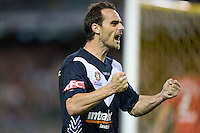 MELBOURNE, AUSTRALIA - OCTOBER 30: Tom Pondeljak of the Victory celebrates a goal by his team mate Carlos Hernandez during the round 12 A-League match between the Melbourne Victory and Adelaide United at Etihad Stadium on October 30, 2010 in Melbourne, Australia.  (Photo by Sydney Low / Asterisk Images)