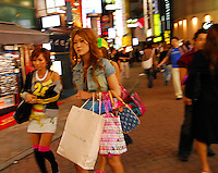Shoppers in Tokyo's busy Shibuya district, Japan. As Japan is seeing the light after over ten years of a stagnant economy public consumer spending is on the increase..
