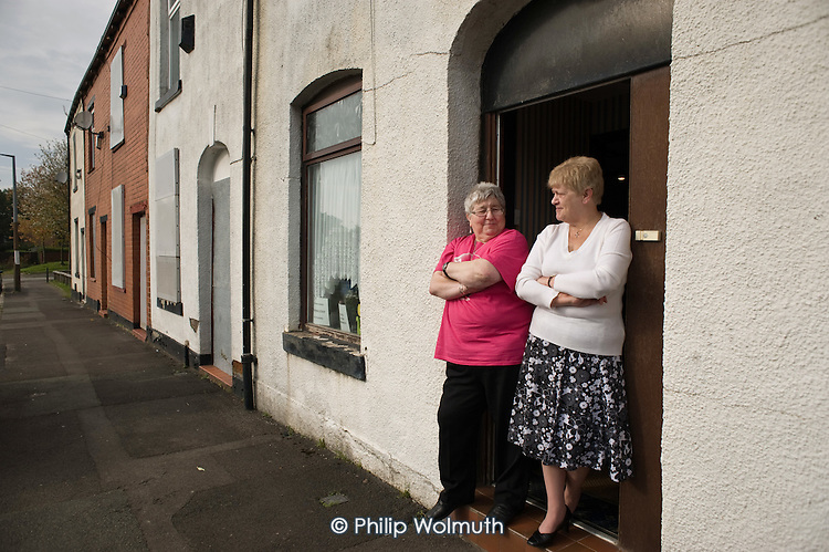 Lynn Ogden (left) is the last remaining resident in Ramsey Street in Derker, Oldham, where she has lived for 43 years. Her ex-neighbour Margaret Rowcroft (right) moved out 2 years ago. The street is scheduled for demolition as part of the Housing Market Renewal programme.