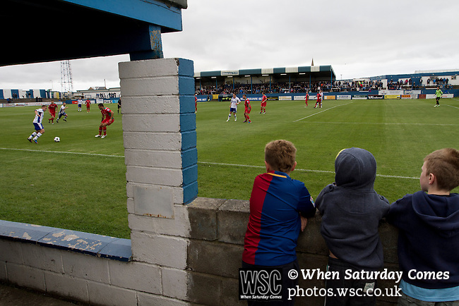 Barrow AFC 0 Newport County 3, 15/09/2012. Furness Building Society Stadium, Football Conference. Three young home supporters watching the action from the terracing at Barrow AFC's Furness Building Society Stadium during the Barrow (white shirts) v Newport County Conference National Fixture. Newport County eventually won the match by 3-0, watched by 802 spectators. Both Barrow and Newport County from Wales were former members of the Football League in England. Photo by Colin McPherson.