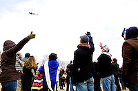 People say goodbye to the departing President George W. Bush as he flies away in a helicopter following Barack Obama's swearing in as the 44th President of the United States in Washington D.C. on January 20th, 2009.