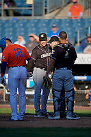 Charlotte Knights manager Mark Grudzielanek and catcher Seby Zavala (5) argue a call with umpire John Mang during an International League game against the Syracuse Mets on June 11, 2019 at NBT Bank Stadium in Syracuse, New York.  Syracuse defeated Charlotte 15-8.  (Mike Janes/Four Seam Images)