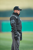 Umpire Brian Fields handles the calls on the bases during the game between the Salt Lake Bees and the Sacramento River Cats at Smith's Ballpark on April 12, 2019 in Salt Lake City, Utah. The River Cats defeated the Bees 4-2. (Stephen Smith/Four Seam Images)