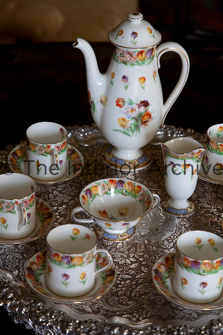 A colourful tea service on an antique tray in the morning room