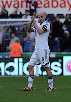 Sunday, 13 April 2014<br /> Pictured: Jonjo Shelvey of Swansea applauds home supporters after the final whistle<br /> Re: Barclay's Premier League, Swansea City FC v Chelsea at the Liberty Stadium, south Wales,