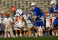Brian McDermott (26) of Virginia sprints past Parker McKee (35) and CJ Costabile (9) of Duke during the ACC men's lacrosse tournament semifinals in College Park, MD.  Virginia defeated Duke, 16-12.