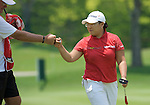 SINGAPORE - MARCH 08:  Jiyai Shin of South Korea celebrates with her caddie on the par tree 11th hole during the final round of HSBC Women's Champions at the Tanah Merah Country Club on March 8, 2009 in Singapore.  Photo by Victor Fraile / The Power of Sport Images