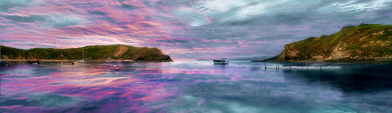 Lulworth Cove at sunrise. Dorset. Jusaasic Coast. England