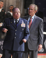 NEW YORK, NY - DECEMBER 03: Staff Sergeant Nicholas Dadgostar hugs Former President George W. Bush during an event to announce a major initiative prior to the 2016 Invictus Games in Orlando, Florida at the Intrepid Sea-Air-Space Museum on December 3, 2015 in New York City. The announcement was to promote the initiative by the George W. Bush Institute in partnership with the Invictus Games to address the invisible wounds of war and a the role of sports in Recovery.<br /> <br /> People:  Former President George W. Bush, Israel Del Toro