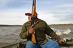 Garney Tizya hunting for caribou on the Porcupine River near Old Crow, Yukon Territory, Canada.