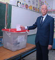Presidential candidate Kais Saied arrives to cast his ballot for presidential election at a polling station in Tunis on September 15, 2019. - Rarely has the outcome of an election been so uncertain in Tunisia, the cradle and partial success story of the Arab Spring, as some seven million voters head to the polls today to choose from a crowded field.<br /> <br /> PHOTO : Agence Quebec Presse -  JDIDI_WASSIM