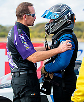 Oct 20, 2019; Ennis, TX, USA; NHRA funny car driver Jack Beckman (left) talks with top fuel driver Jordan Vandergriff during the Fall Nationals at the Texas Motorplex. Mandatory Credit: Mark J. Rebilas-USA TODAY Sports