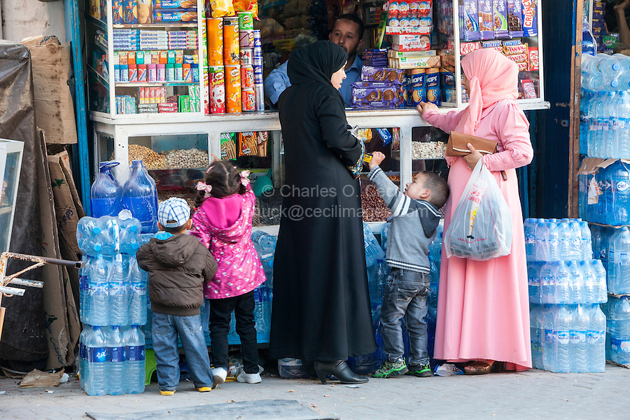 Essaouira, Morocco.  Mothers Buying Snacks for Children, Avenue de l'Istiqlal.