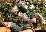 HIT, Iraq- (July 4, 2005) A member of the Iraqi Security Force (ISF) pours water from his helmet onto another ISF's head, who is trying to wash his hair of sweat and sand from patrolling all day. During Operation River Sweep III, the Marines of 2d Marine Division conduct counter- insurgency operations with Iraqi Security Forces to isolate and neutralize anti-Iraqi forces, to support the continued development of Iraqi Security Forces, and to support Iraqi reconstruction and democratic elections in order to create a secure environment that enables Iraqi self-reliance and self-governance. (Official USMC photo by LCpl. Shane S. Keller)