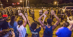 """BATON ROUGE, LA -JULY 10: Protesters shout """"Hand up, don't shoot"""" as law enforcement gather before charging the protesters to make arrest on July 10, 2016 in Baton Rouge, Louisiana. Alton Sterling was shot by a police officer in front of the Triple S Food Mart in Baton Rouge on July 5th, leading the Department of Justice to open a civil rights investigation. (Photo by Mark Wallheiser/Getty Images)"""